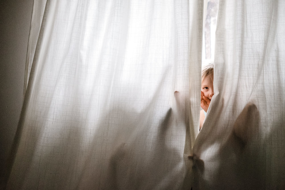 kids-peeking-curtain-vancouver-documentary-photographer