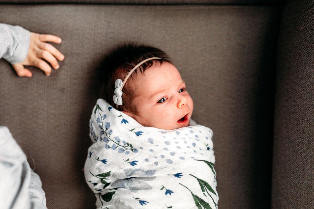 kid-baby-lying-couch-coquitlam-newborn