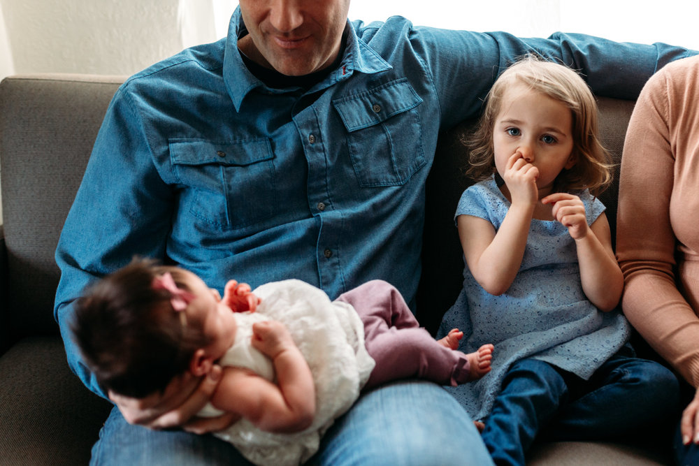 mom-kid-newborn-picking-nose-girl-port-coquitlam-photography