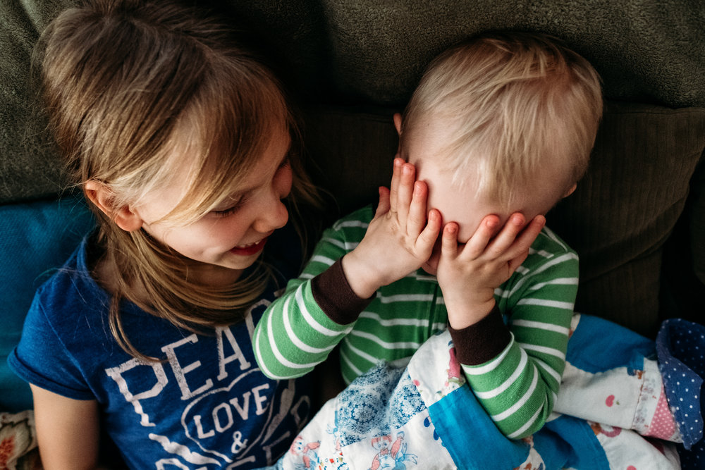 kids-laughing-covering-eyes