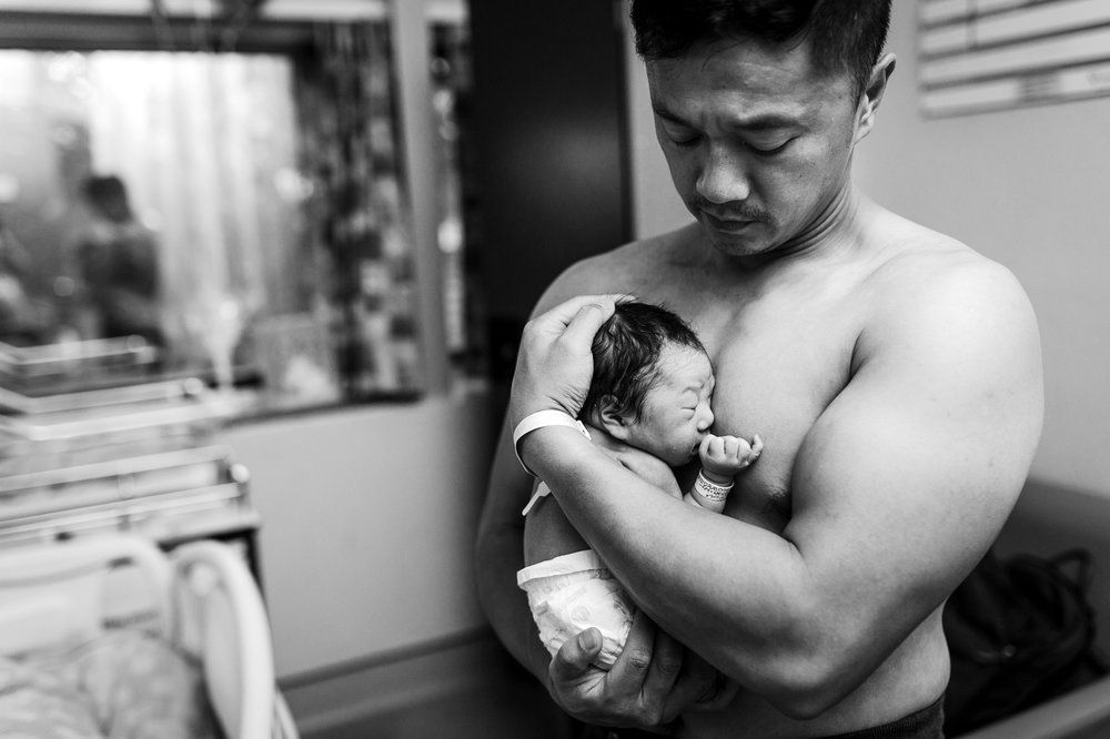 asian dad holding newborn baby skin to skin vancouver surrey