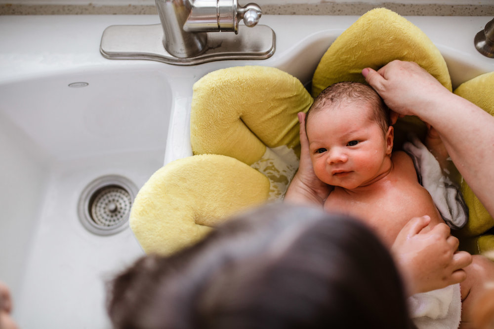 philippino baby in a sink bath with blooming baby bath yellow pitt meadows
