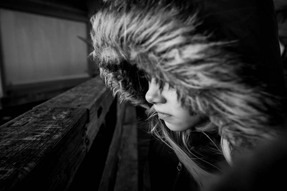 girl in furry hood looking out