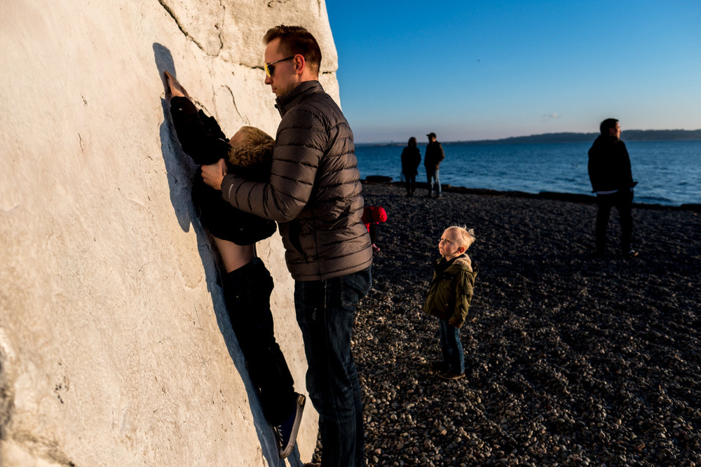 kids climbing white rock in canada cold dad
