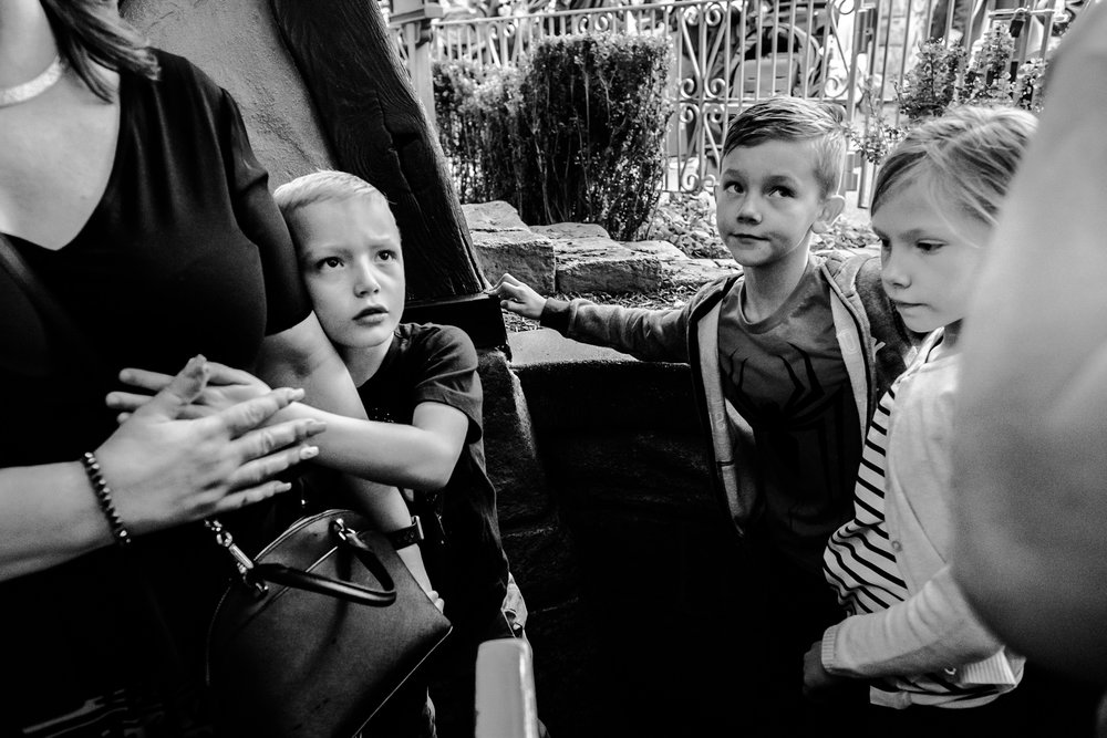 kids making expressions while waiting in line vancouver documentary photographer