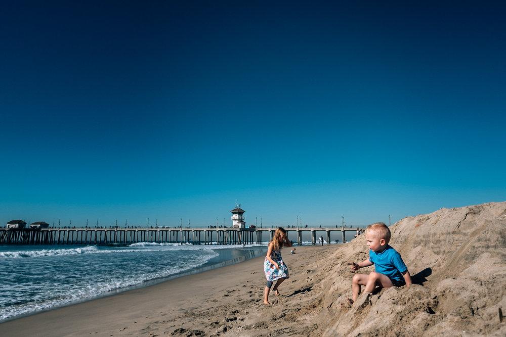kids sitting on the beach