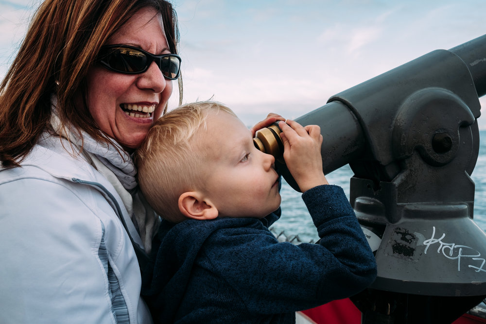 aunt and child looking through view finder