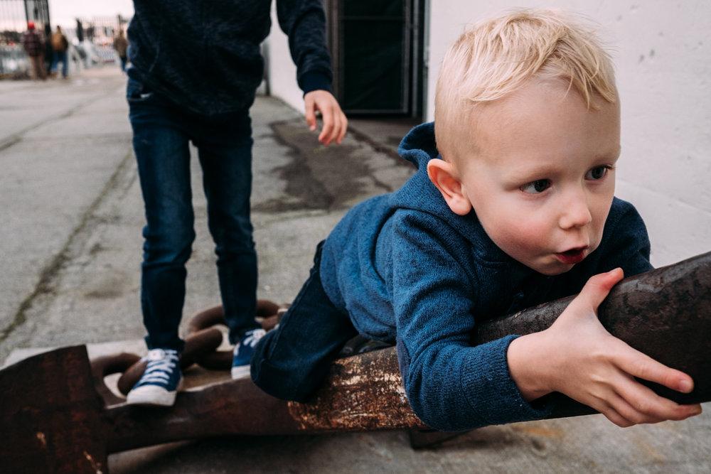 toddler climbing on a giant anchor