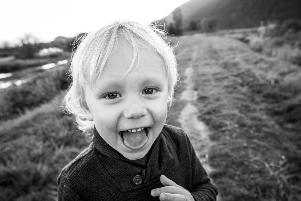 boy at pitt lake smiling for camera goofy