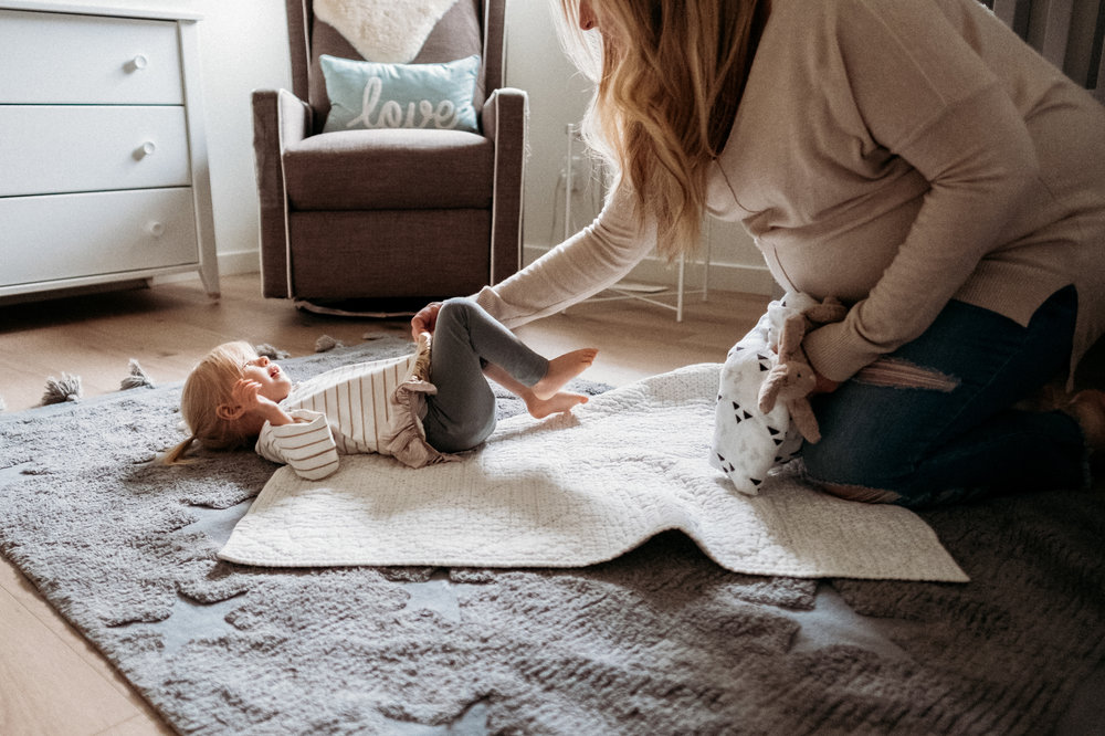 mom-playing-daughter-nursery-pregnant.jpg