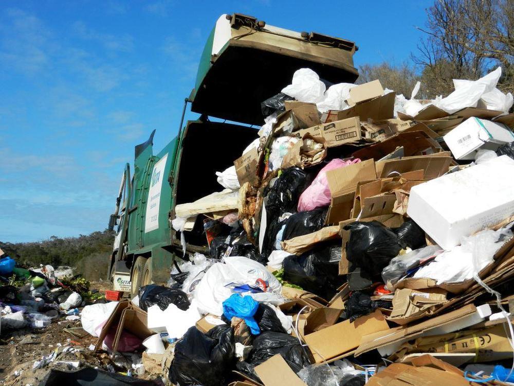 Waste truck discharge.jpg