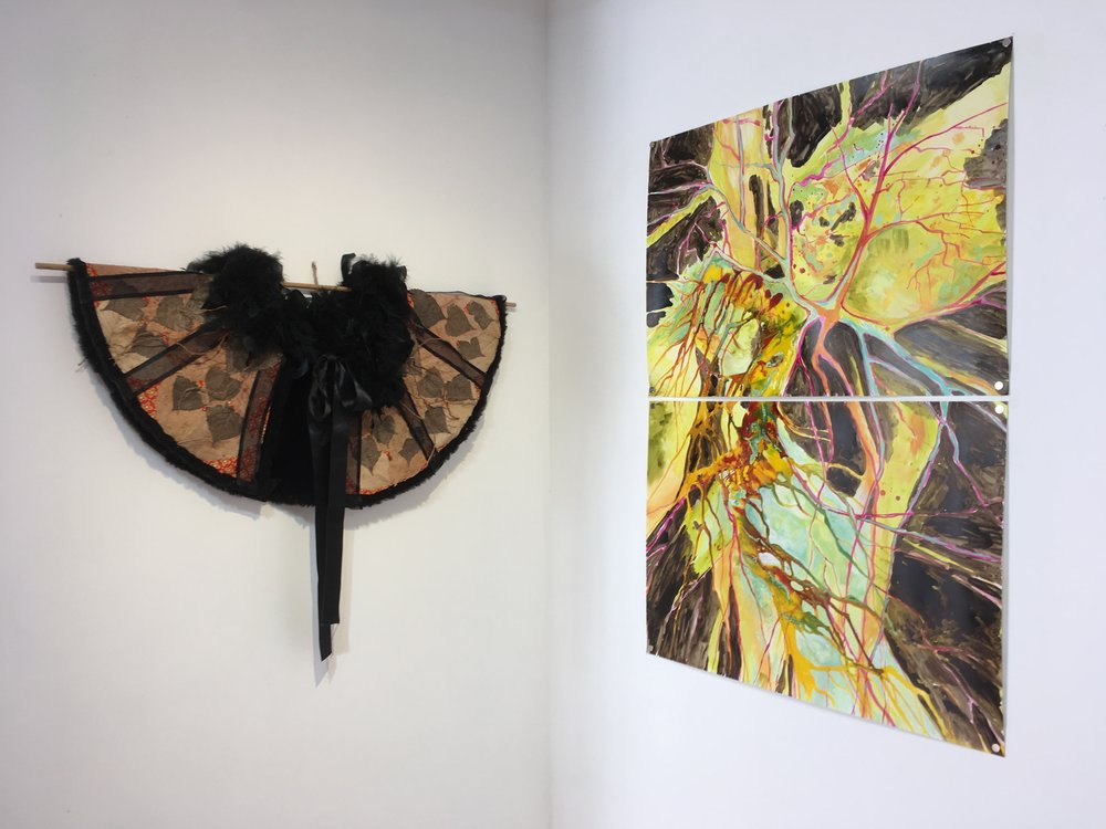 "L: Wendy Copp,  Madame Butterfly  (wearable), 2013. maple and  cottonwood leaves, curly willow, fake fur, feathers and ribbon. R: Jessica Mongeon,  Dendritic Tree  (diptych), 2016. acrylic on stone paper, 40""x28"""