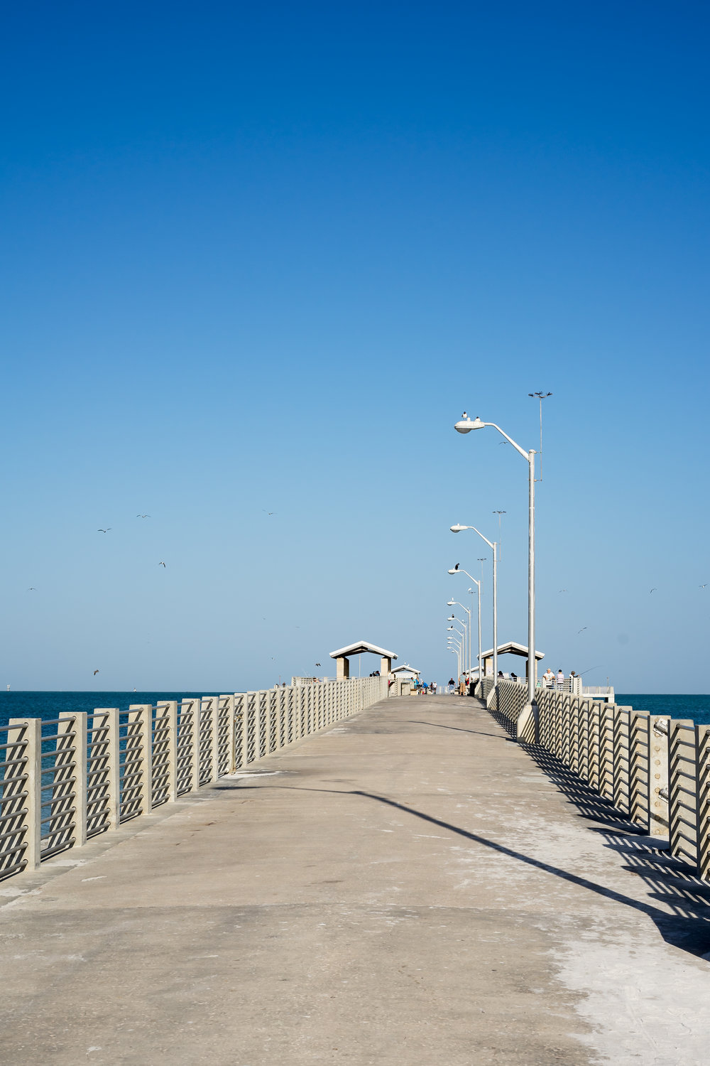 The Gulf Pier on Easter morning. A rare sight as it is usually crowded with fisherman and beach goers every weekend.The Gulf Pier is noted for sheepshead, pampano, Spanish mackerel, King fish, tarpon and cobia. This location also has snacks, bait, and assorted beach items at their shop.