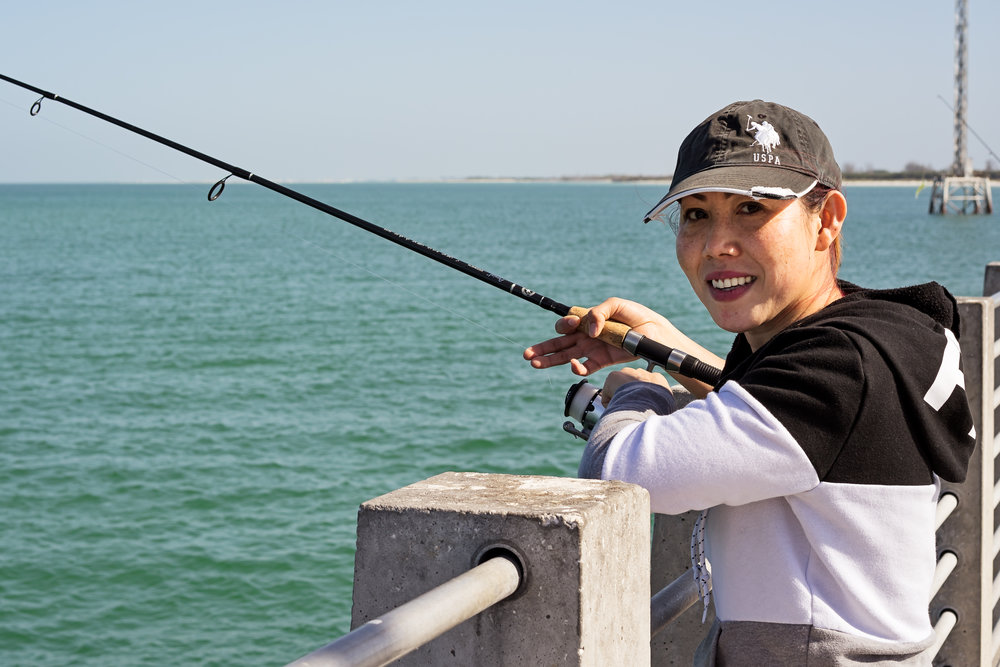 Lynn, one of the many female fishermen, fishing off the Gulf Pier. Her bubbly personality and energy were contagious. She not only caught fish but took fish other people did not want that day. Lynn stated the she just loved to eat fish!