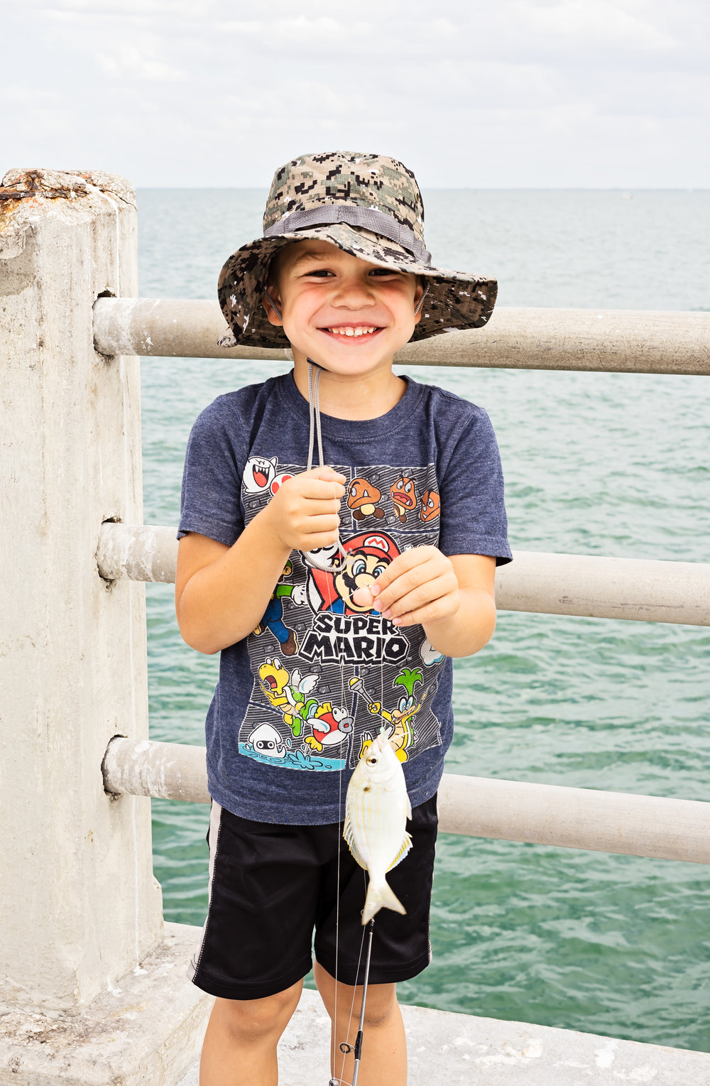 Matthew, out on the pier with his grandfather, caught this pinfish.
