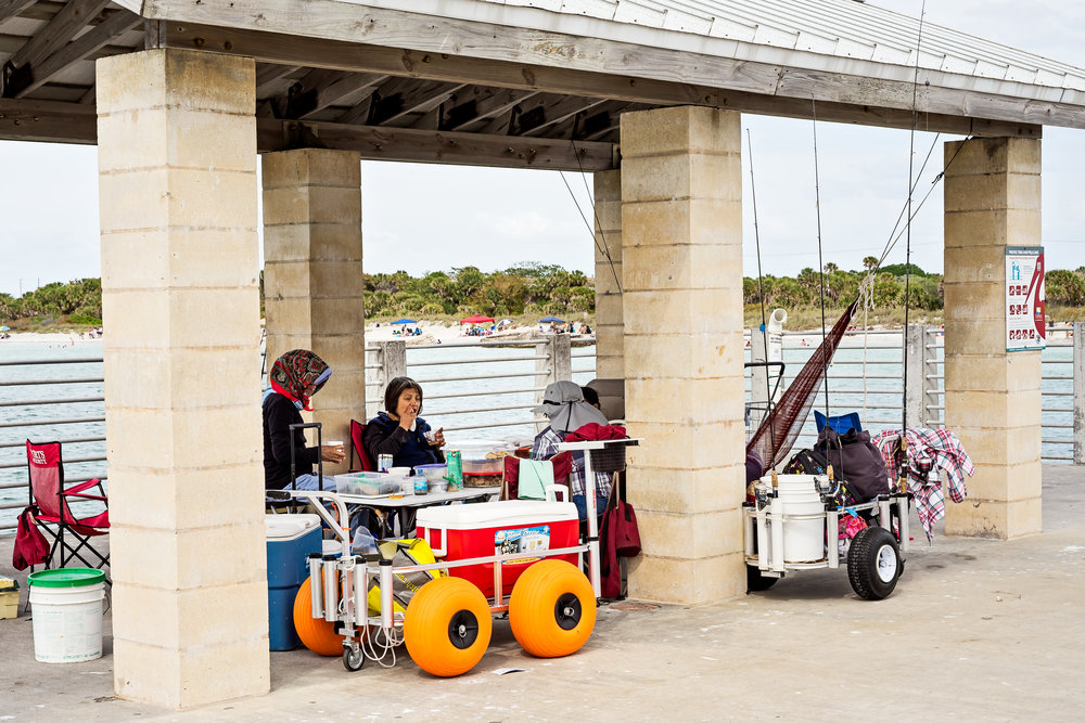 This group of ladies made quite a spread for everyone in their fishing party. They also had carts with large wheels making it easier to pull all thier fishing gear and picnic items through the sand.