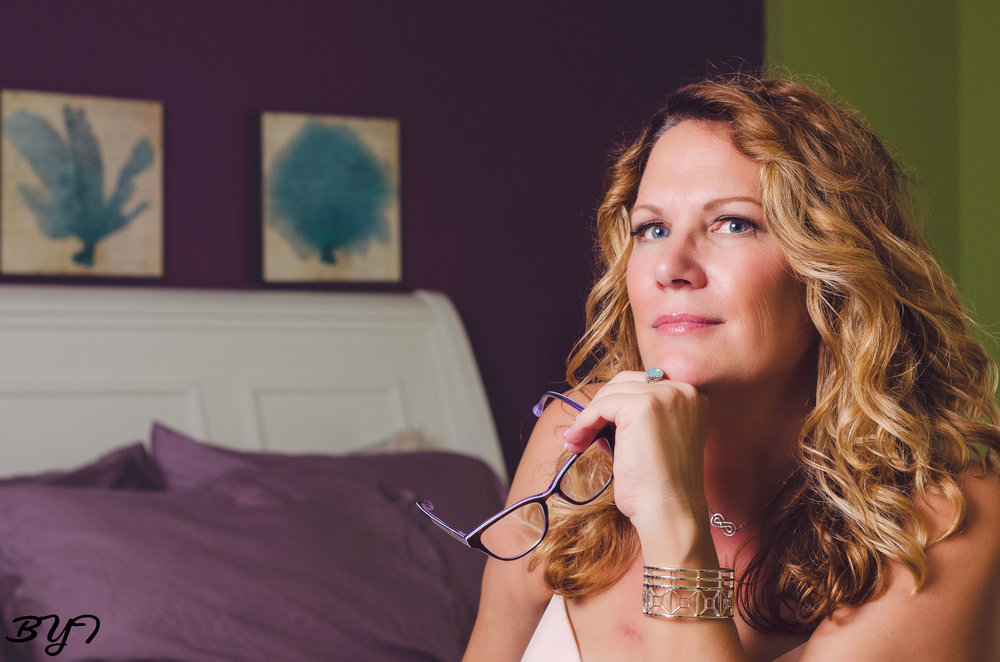 Here we are in a clients home doing a styled boudoir shoot.