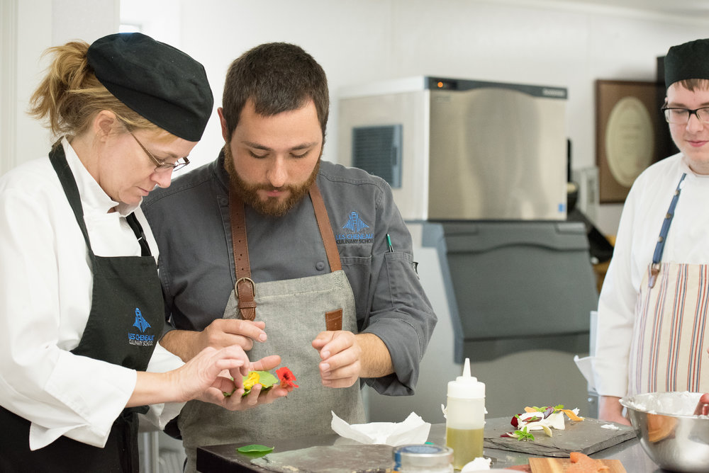 Images Courtesy of Alexander husarek From Left: Student Marcy Misner, Chef Instructor Zach Schroeder, Student T.J. Lee