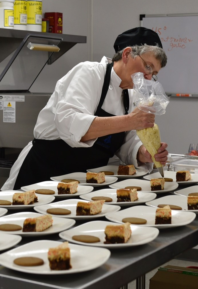 Sandy Bergstrom at work with desserts