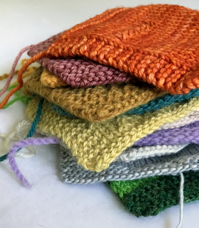 Swatches for determining gauge in hand knitting.