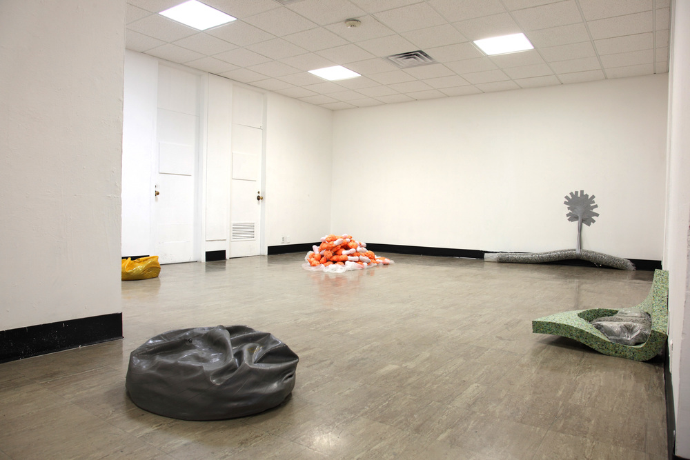 SPENT ,2012  mortar, concrete, exercise balls, carpet padding, plastic, duct tape, insulating spray foam, socks, petroleum jelly  photograph by Katrin Winkler