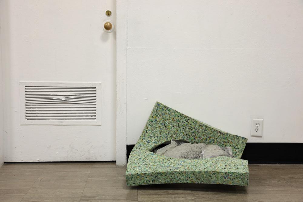 SPENT ,2012  carpet padding, concrete, plastic  photograph by Katrin Winkler