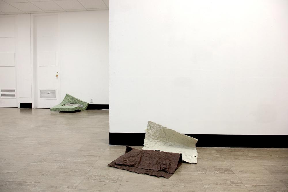 SPENT ,2012  tissue paper, spray paint, petroleum jelly, concrete, carpet padding, plastic  photograph by Katrin Winkler