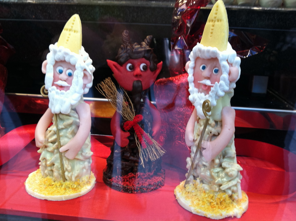 Krampus and St. Nicholas desserts in a bakery window in Vienna.