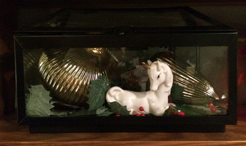 Nothing says Merry Christmas like a unicorn trapped in a holly-filled terrarium