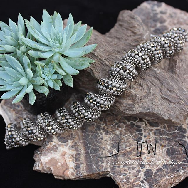 Happy New Year everybody! 🎆 Let's kick 2017 off with some killer launches. ⚜️ Introducing the Aurum Cellini Spiral Bracelet ⚜️ This bracelet has always been one of my best sellers from its bold look and incredibly architectural design.  Now I'm creating it in a striking new color way that combines metallic argent and aurum tones with chic matte grey.  Drama and sophistication reign! 👸 ⚜️ At the pinnacle of sculptural bead weaving is the Cellini Spiral.  Undulating from the smallest and most delicate of glass seed beads to the crest of a crashing wave of shimmering Swarovski.⚜️