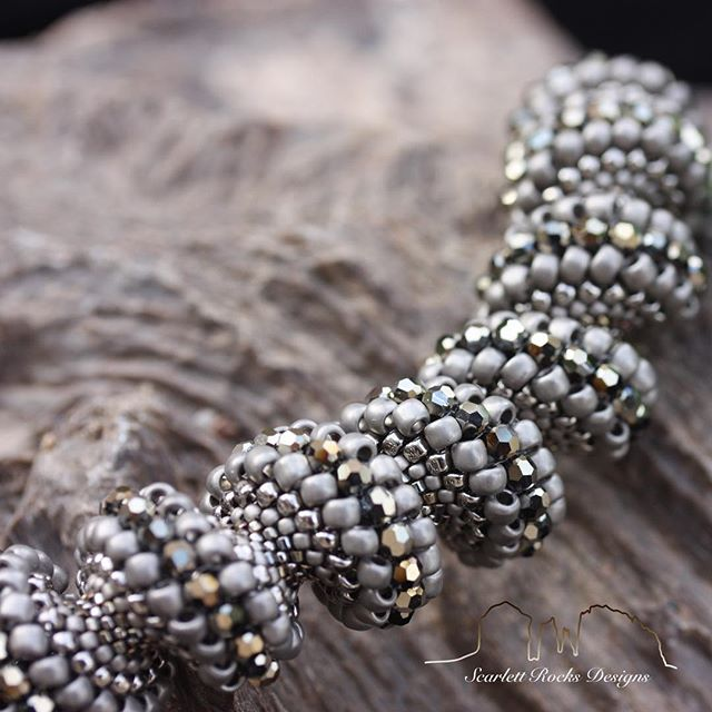 Let the serpentine 🐍seduce you. ⚜️ Let's get an up close look 👁 In this stand out piece I have combined matte and metallic versions of argent and aurum with chic grey.  This compelling combination makes it a great pairing to silver OR gold toned companion pieces.  This sparkling masterpiece would punctuate a black ensemble with great drama or be the star of any outfit.