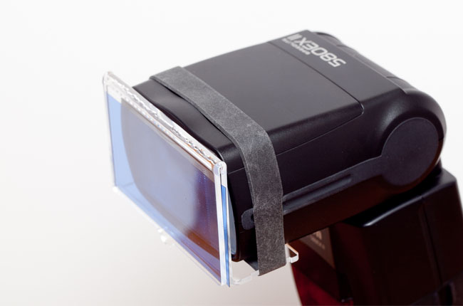 (Image: flash gel holder attached to a speedlight)