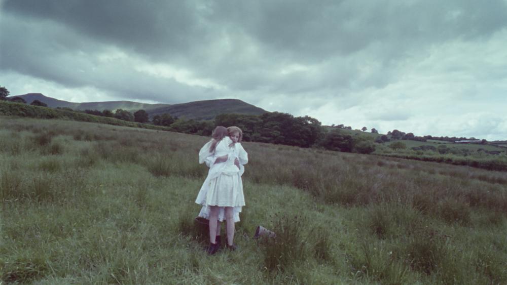 lizzie and laura hug in field.jpg