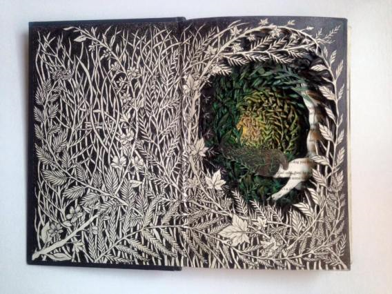 Carved and layered altered book by Isobelle Ouzman