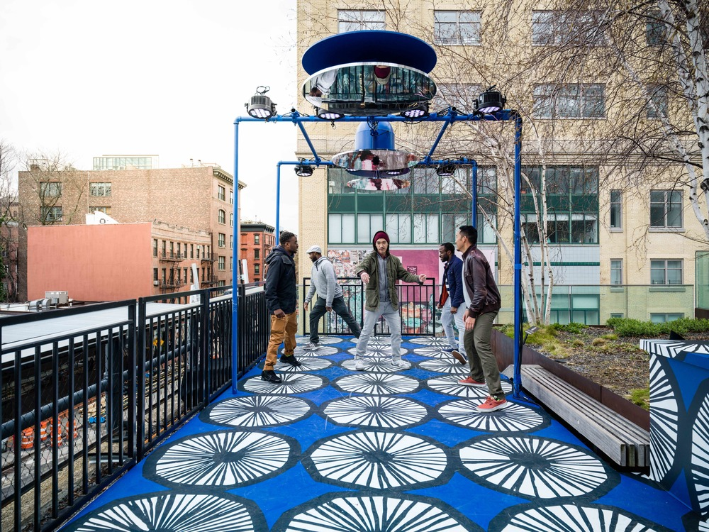 The third activation, called Appelsiini Soundboard after the circular print that covers a section of the High Line, invites pedestrians to stand on a large soundboard and dance. The dancing activates music. The more people dance, the richer the sound becomes, until it can be heard inside of the other activations and throughout the park.