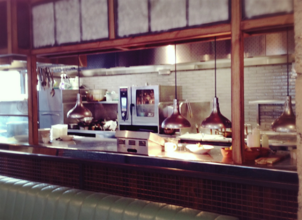 Image by  Kelly Chang , open kitchen in Jamie's Italian