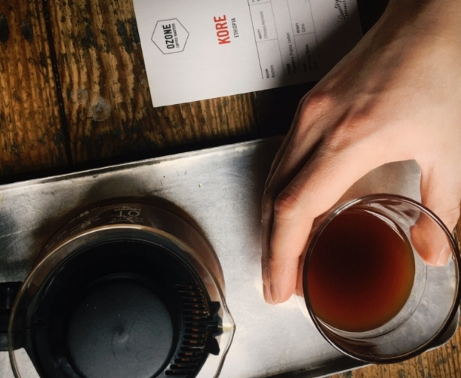Image by  Kelly Chang , a cup of hand-brewed coffee comes with a tasting note