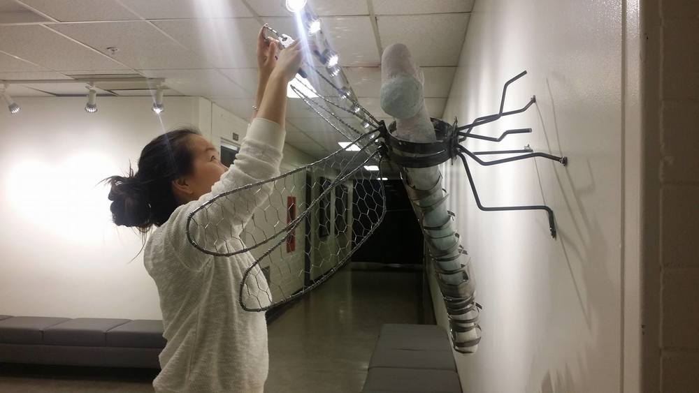 Emily May, December 2015. Installing Dragonfly Sculpture.