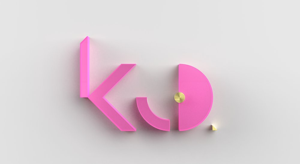 KCD logo-TOP - pink acrylic & brushed brass.390.jpg
