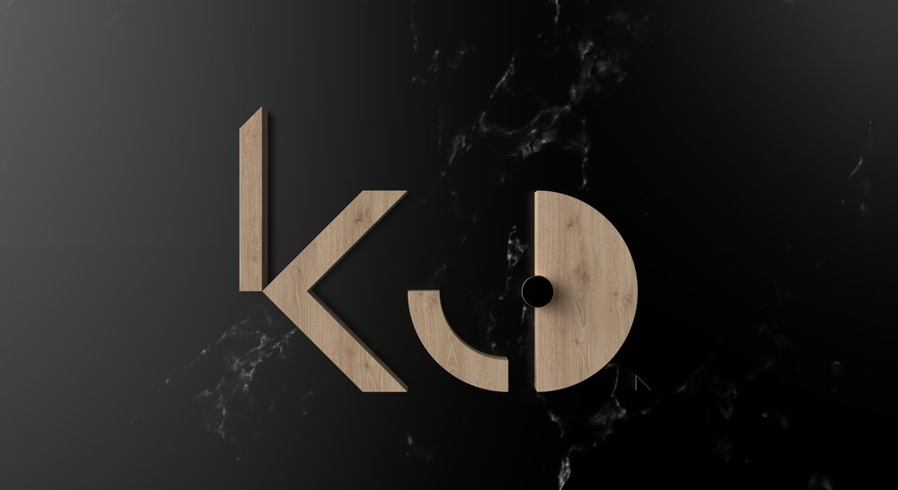 KCD logo-light wood & black marble-white marble background.402.jpg