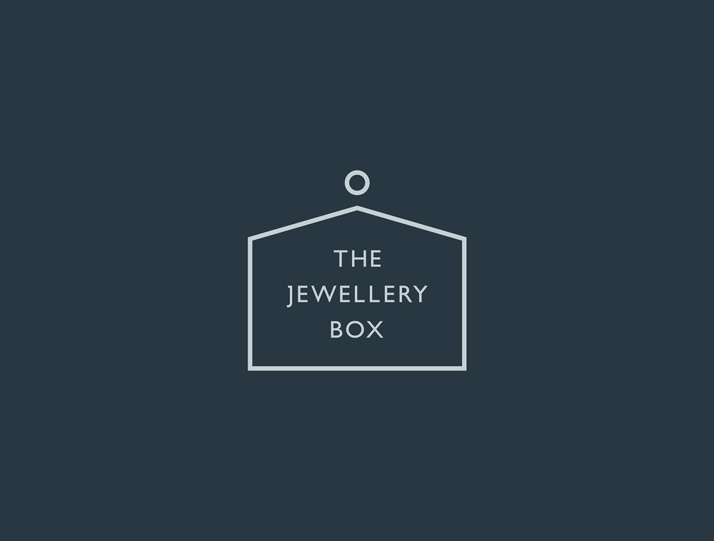 TJB_Boxed Logo Light Grey on Dark Grey.jpg