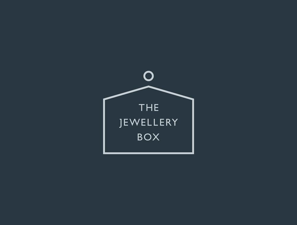 TJB_Boxed Logo Light Grey on Dark Grey.jpg