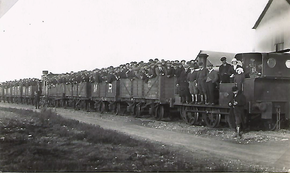 Workers on the Tackeroo.   This photograph was probably part of a publicity shoot when the line was opened because you can see a lady and two children at the front. Troops did not ride the carriages but the workers did, which meant a cut in pay as they used to get an allowance to walk to work. This caused a short 'strike' by the workers until they realised they were being paid more than the troops who were getting shot at!