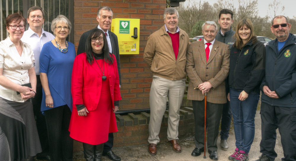 From left to right: Trudy Williams (Clerk to Brindley Heath Parish Council), Robert and Debby Lugar (One Another Ministries), County Councillor Mrs Christine Mitchell, County Councillor George Adamson, Councillor Paul Adams (Chairman of Brindley Heath Parish Council), District and Parish Councillor Alan Pearson, Jamie Richards (Head of AEDdonate), Fay Cooper (Rugeley and District Community First Responders) and James Shuttleworth (Rugeley and District Community First Responders)