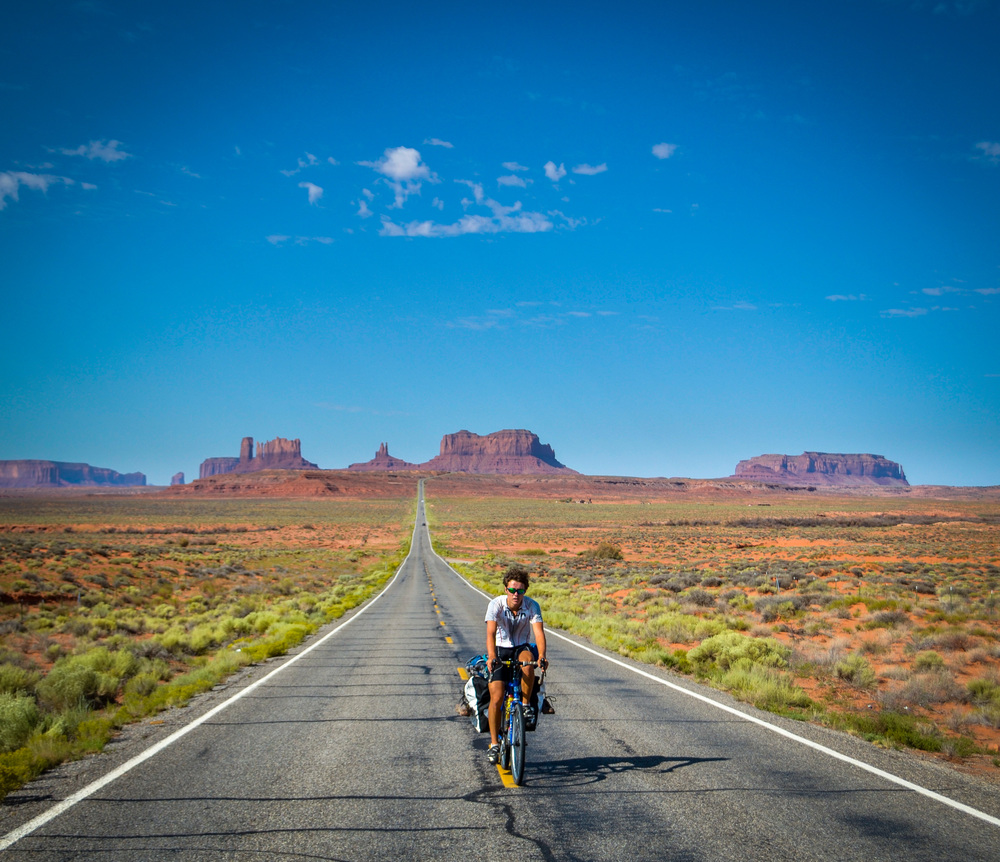 Dan cycling away from Monument Valley