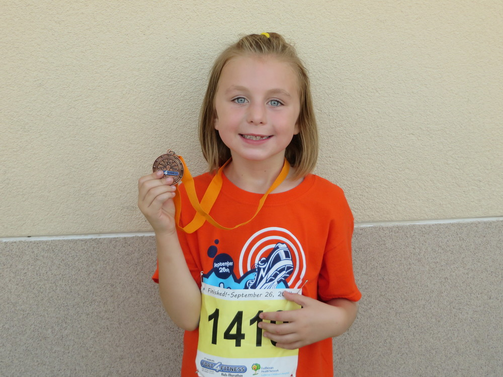 Ella with her finishers medal