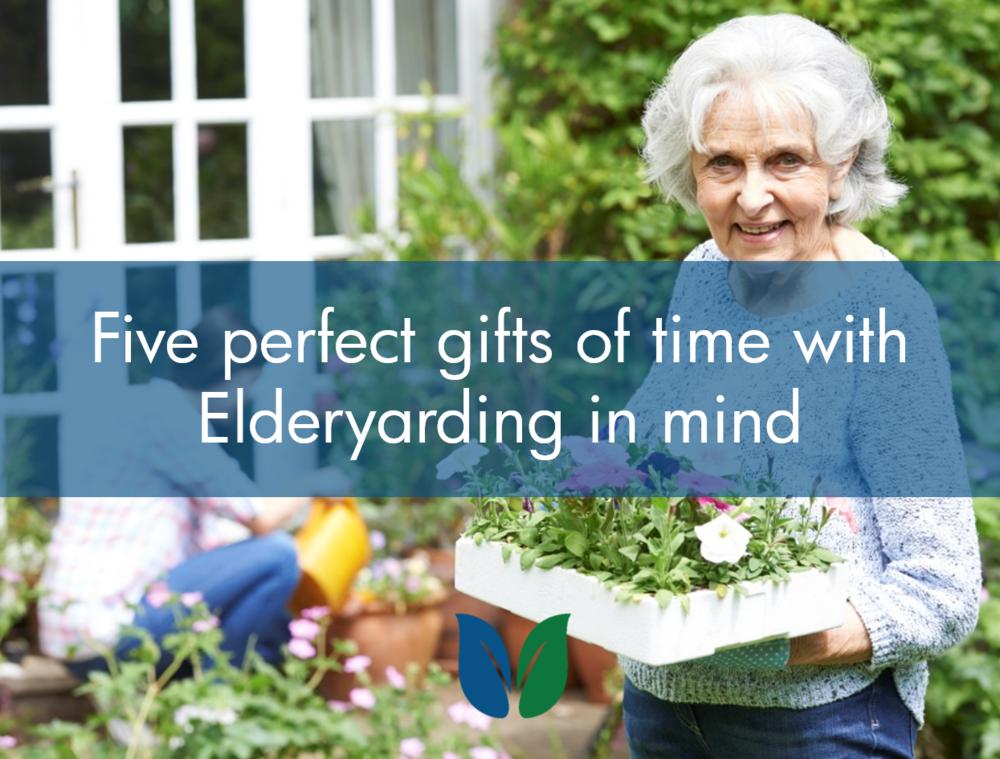 Senior woman with teenaged grandchild helping in garden