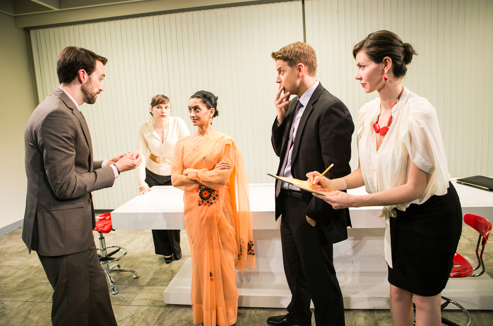 Production photo from San Francisco Playhouse production of   Trouble Cometh ,  directed by  May Adrales .   The team pitches their idea to management. (L-R: Joe [Kyle Cameron] , Susan [Marissa Keltie], Vashti [Nandita Shenoy], Dennis [Patrick Russell], Kelly [Liz Sklar]). Photo by Jessica Palopoli.