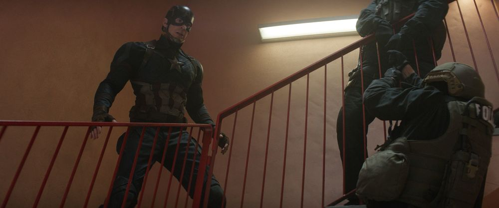Captain America throwing police off stair cases to save Bucky, a wanted murderer.