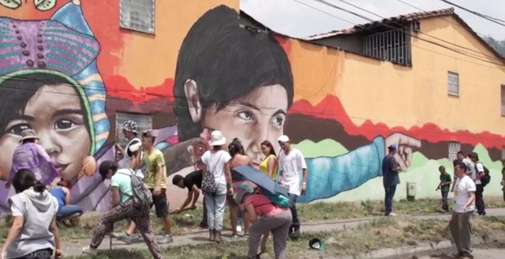 Project Attica collaborates with Agroarte, a collective that unites agriculture, art and hip-hop for community empowerment and building resistance against oppression in the community. Based in Medellin, Colombia, Agroarte takes over abandoned and neglected spaces teaching the youth about urban agriculture and self-expression through music and lyrics. Read more  here .  Video still by Lorena Acevedo.